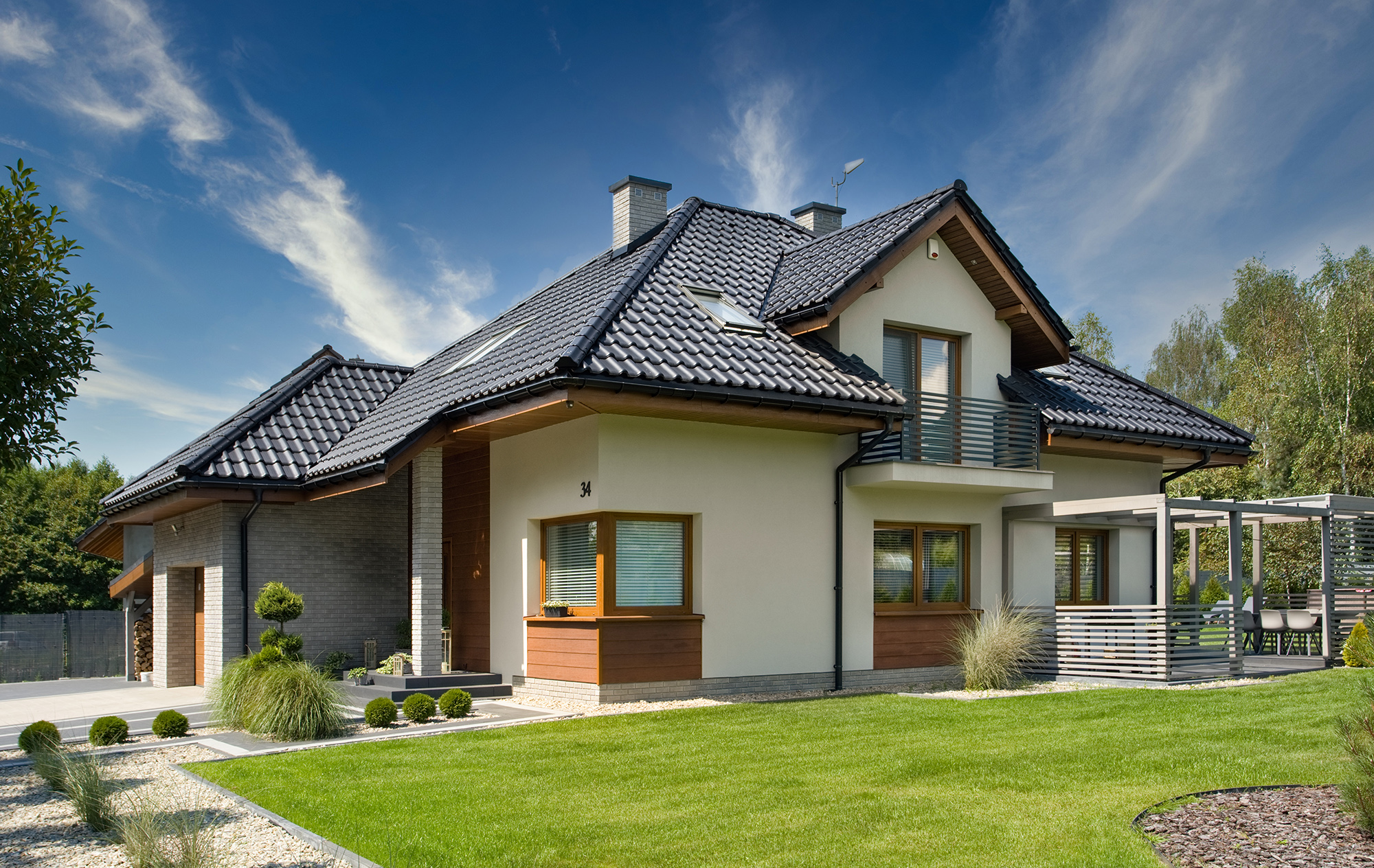 Dom w sansewieriach z dachówką TITANIA marki CREATON według projektu ARCHON+